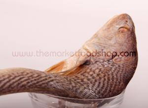 Whole croaker fish in a bowl